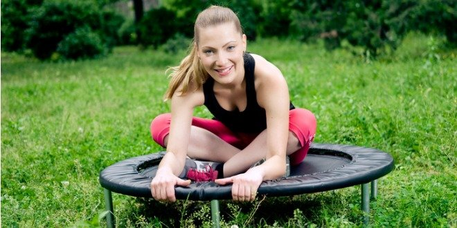 Woman stretching before her trampoline workout
